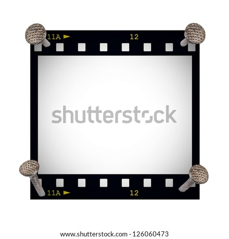 blank film strip frame with metal nail isolated on white background - stock photo