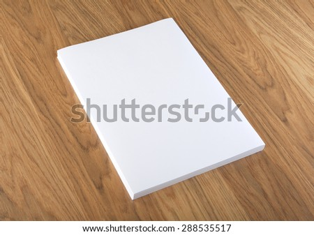 Blank flyer poster on wood to replace your design - stock photo