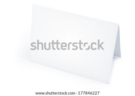 Blank folded card on white - stock photo