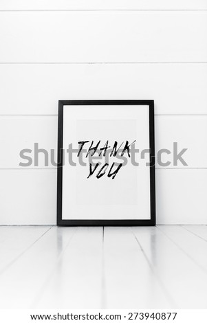 Blank frame on a white background with quotation. Thank you. - stock photo