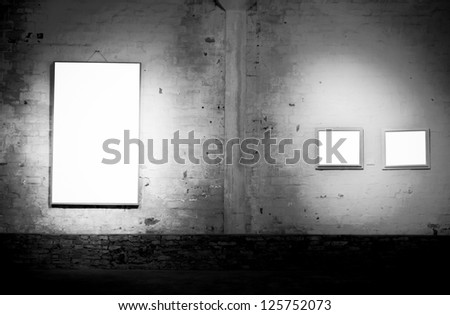 blank frame on vintage old wall - stock photo
