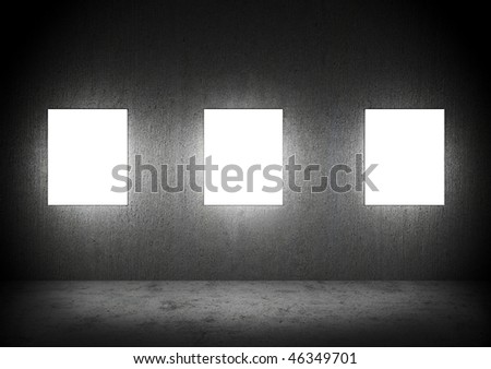 Blank frames in a dark Concrete room - stock photo
