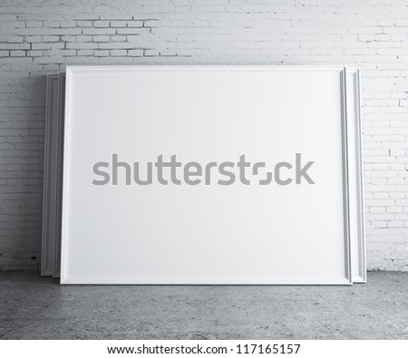 blank frames in concrete room - stock photo