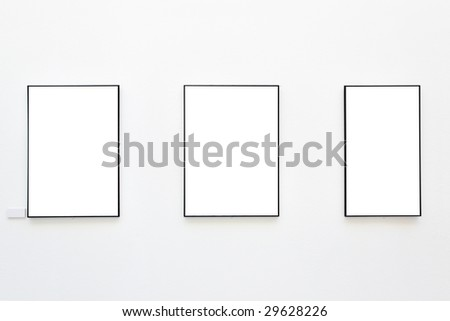 Blank frames on the wall at art gallery - stock photo