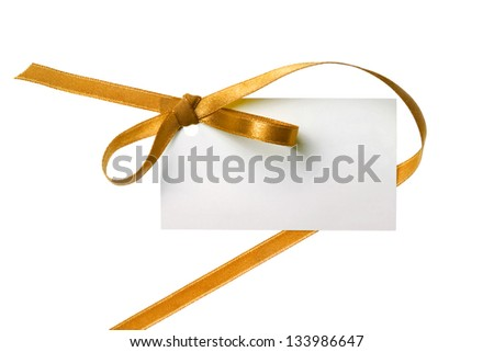 Blank gift tag tied with a bow of gold satin ribbon. Isolated on white, with soft shadow - stock photo