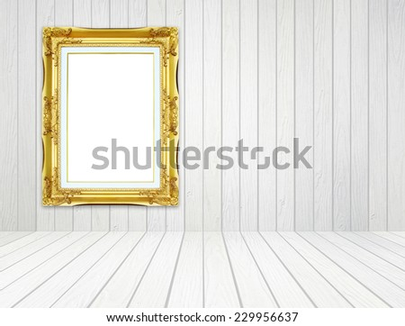 blank golden frame in room with white wood wall and wood floor background - stock photo