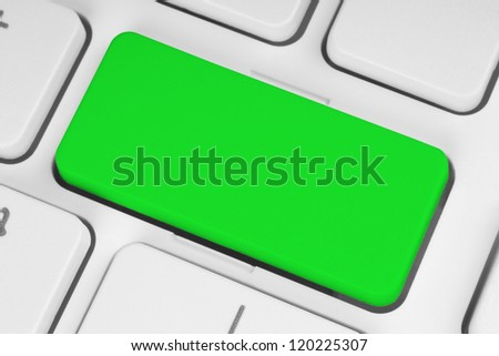 Blank green button on the keyboard close-up - stock photo