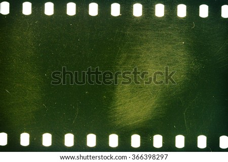 Blank green grained scratched film strip texture background  - stock photo