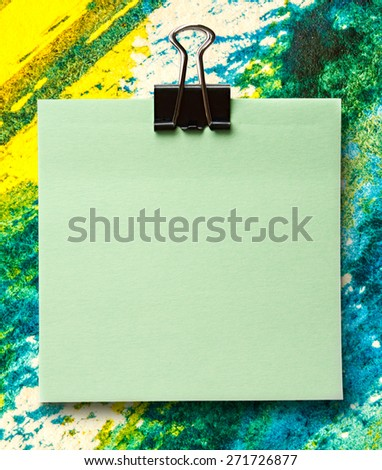 Blank green sticker and black clip surface - stock photo