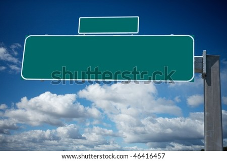 Blank green traffic billboard against cloudy sky - stock photo
