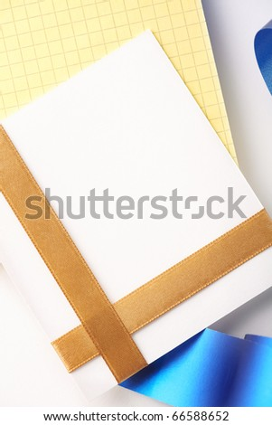 Blank greeting card on blank yellow spiral note book. - stock photo