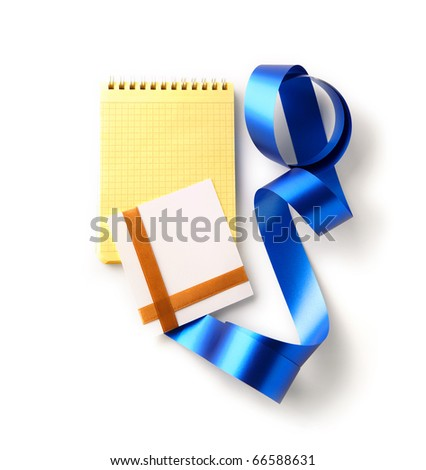 Blank greeting card with blank yellow spiral note book and curved ribbon. Isolated. - stock photo