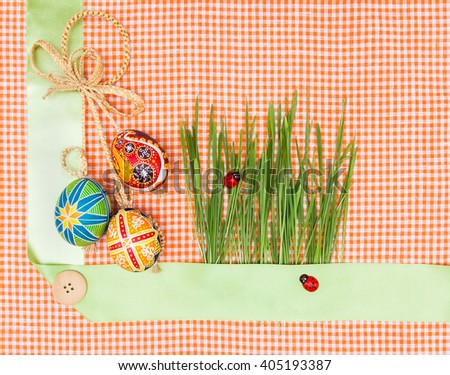 Blank, greeting easter card with green grass and handmade easter eggs - stock photo