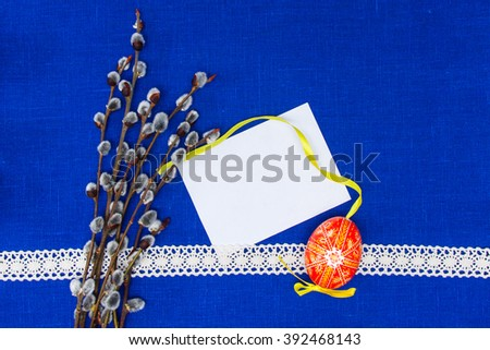 Blank, greeting easter card with vine,red easter egg in blue textile background - stock photo