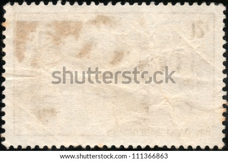 Blank grunge postage stamp isolated on a black background - stock photo