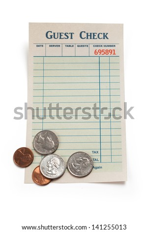 Blank Guest Check and Coin, concept of restaurant tip. - stock photo