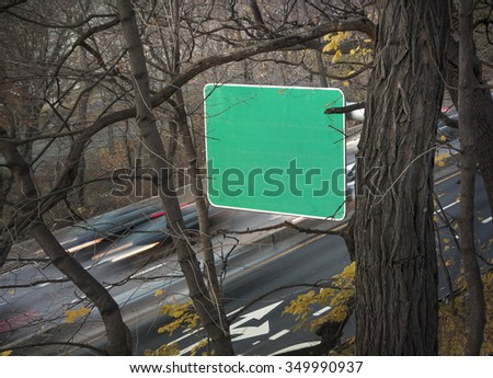 blank highway road sign with traffic - stock photo