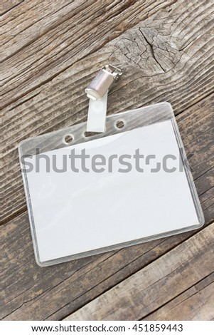 Blank ID card tag on wooden background - stock photo