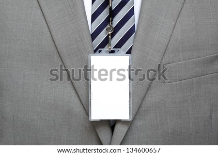 Blank identity name tag on a businessman suit on a lanyard - stock photo
