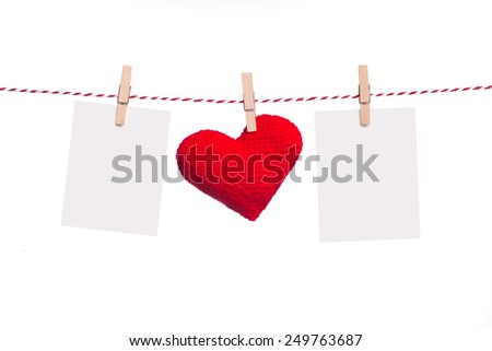 Blank instant photo and red paper heart hanging on the clothesline. Isolated on white. - stock photo