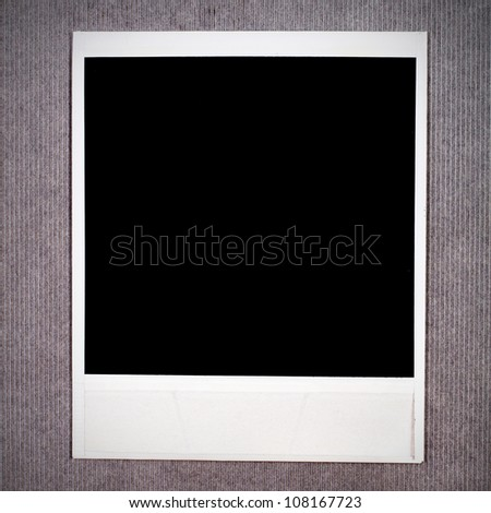 Blank instant photo frame on a cardboard background - stock photo
