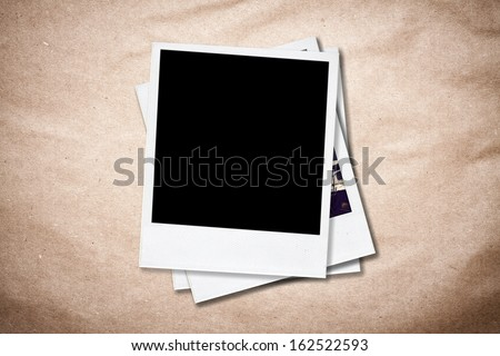 Blank instant photo frames on old paper background. - stock photo