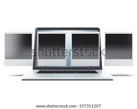 Blank instant photo frames over laptop - stock photo