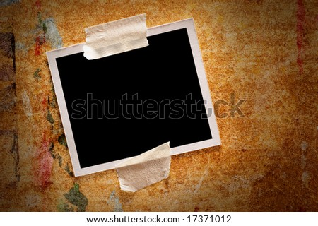 Blank instant photo over wooden background - stock photo