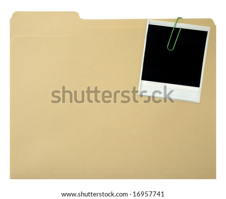 Blank instant print clipped to manila folder - stock photo