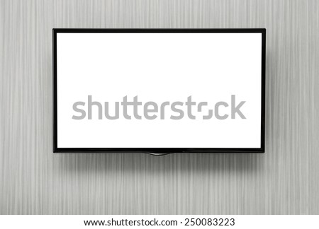 Blank lcd TV hanging at the wall with copy space and clipping path for the screen - stock photo