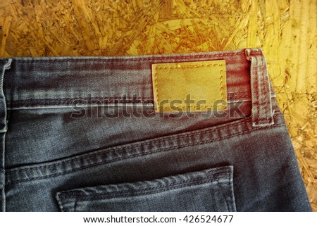 Blank leather jeans label sewed on a jeans - stock photo
