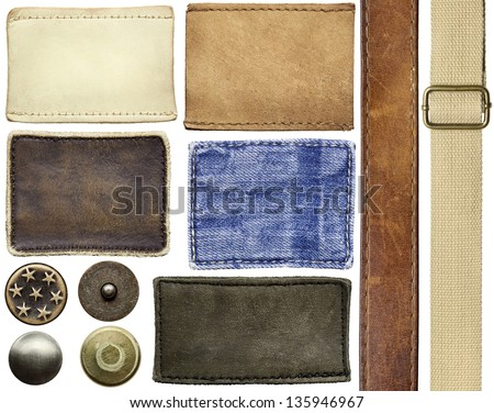 Blank leather jeans labels, buttons, rivets, straps. - stock photo