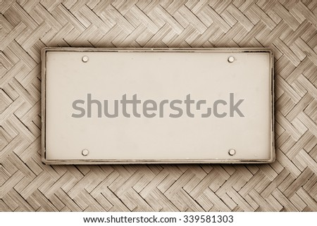 blank license plate on basketwork twill weave pattern ,vintage tone - stock photo