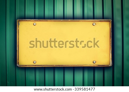 blank license plate on metal sheet ,vintage tone - stock photo