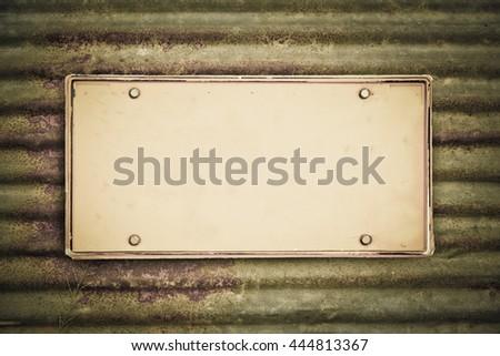 blank license plate on rusty galvanized iron - stock photo