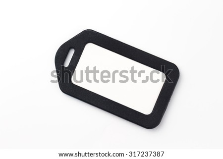 Blank luggage tag on white background - stock photo