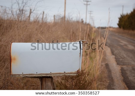 Blank mailbox on country road.  - stock photo