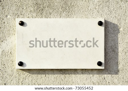 Blank marble signboard close-up over wall - stock photo