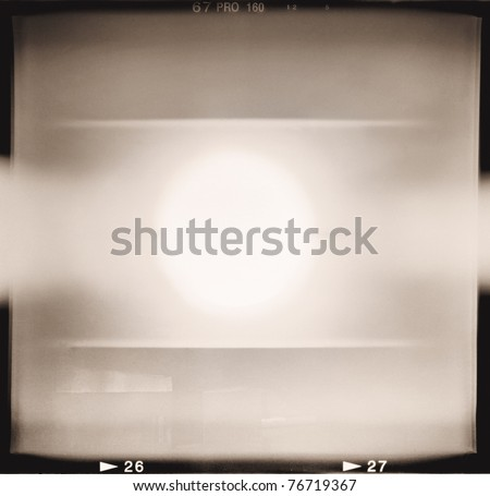 Blank medium format (6x6) monochrome film frame with abstract filling containing light leak in center, grain effect added - stock photo
