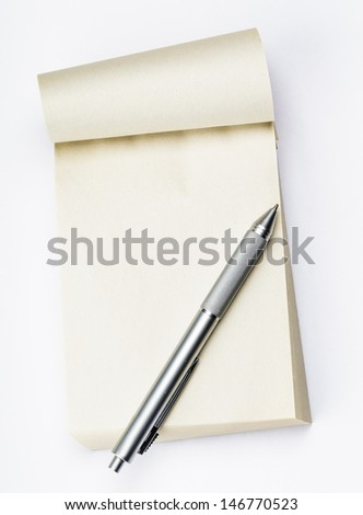 Blank memo pad with pen - stock photo