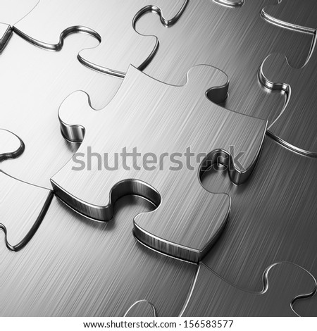 Blank metal jigsaw puzzle - stock photo