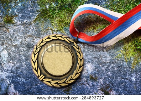 Blank metal medal with tricolor ribbon closeup - stock photo