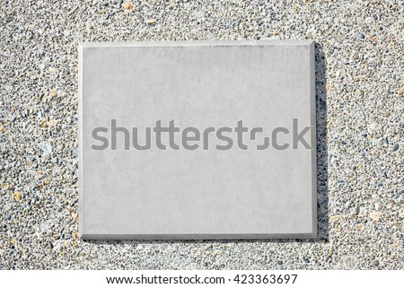 Blank metal plaque mounted on an old concrete wall. - stock photo