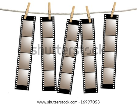 Blank 35mm Film Strip Negatives Hanging From A Rope By Clothespins - stock photo