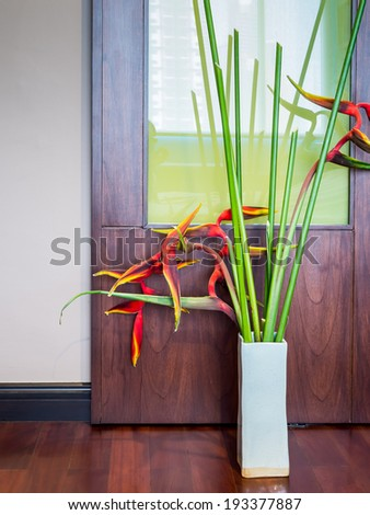 Blank modern interior room with flowers in ceramic vase - stock photo