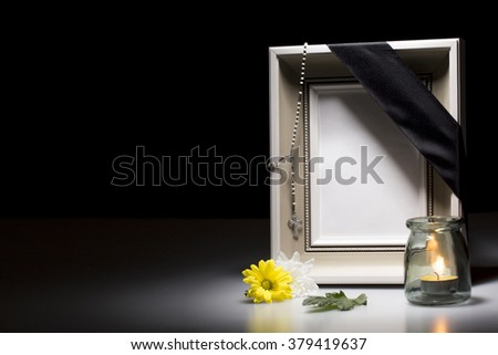 blank mourning frame with flower and candle for sympathy card - stock photo