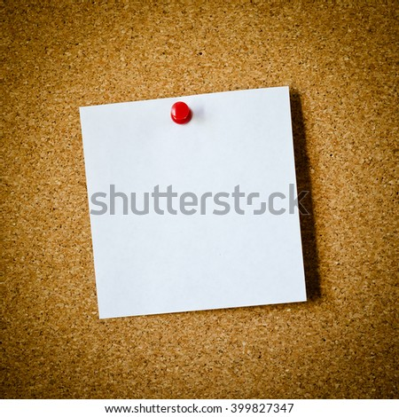 blank note paper on a cork board - stock photo