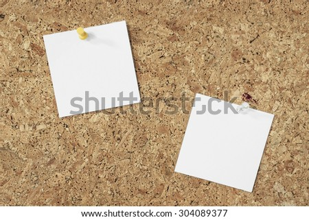 blank note paper pinned on a cork background - stock photo