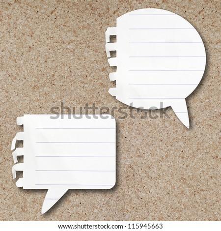 Blank Note Paper Speech Bubbles On Cork Board - stock photo
