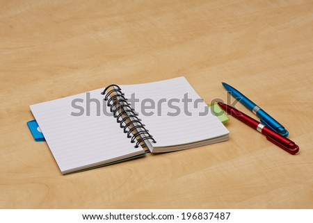 Blank note paper with ballpoint pens on the desk - stock photo